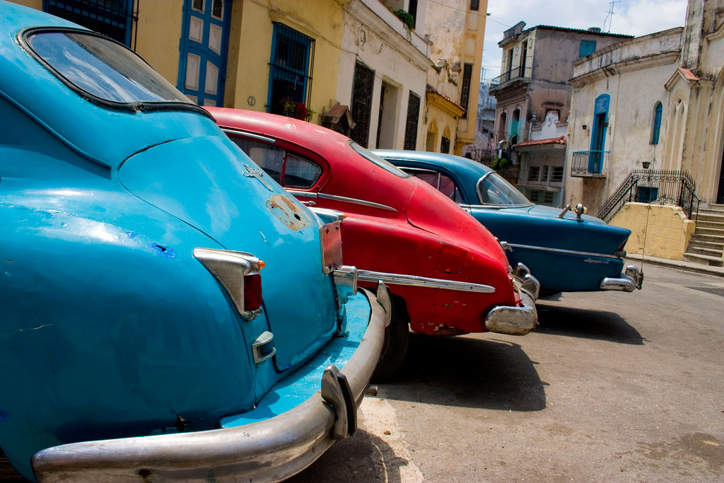 3 old cars lined up in Havana, Cuba