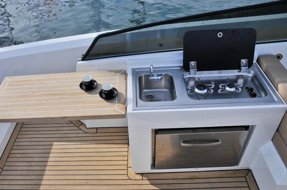 Aft deck mini galley on the vanquish express cruiser