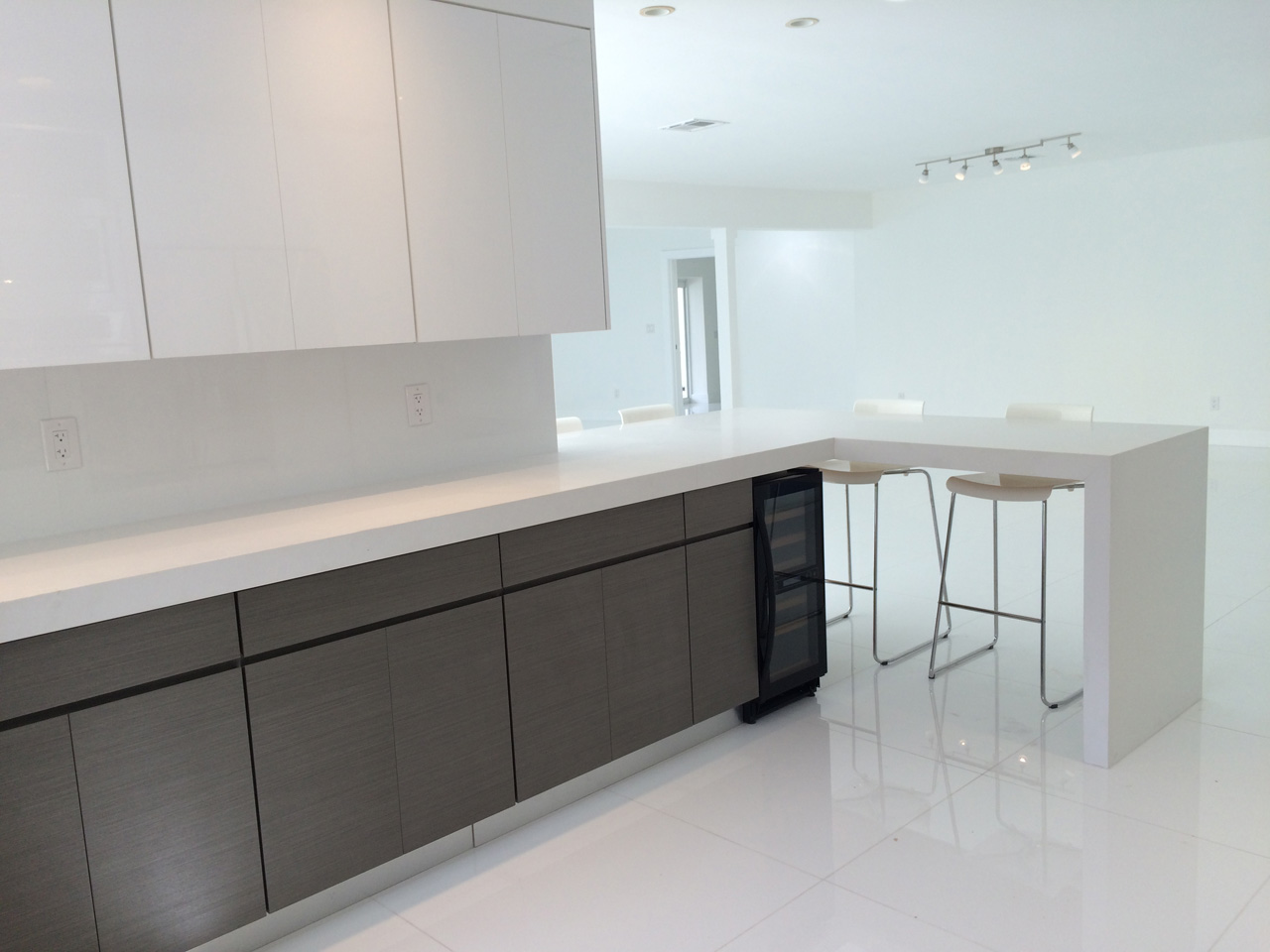 quartz countertops with waterfall effect and wine cooler. keystone point home for sale