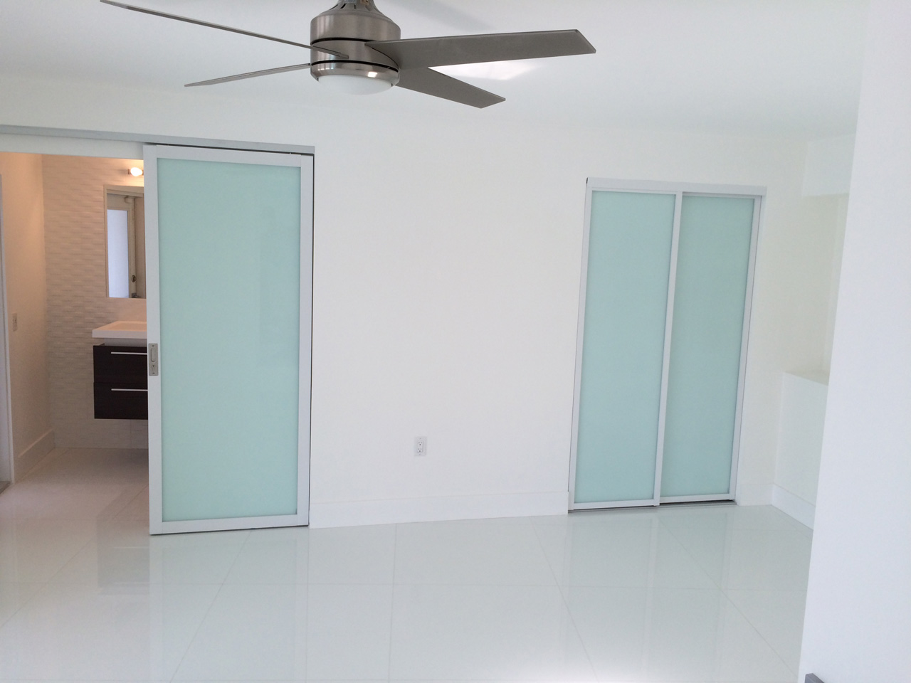 Custom sliding glass doors throughout this property for sale