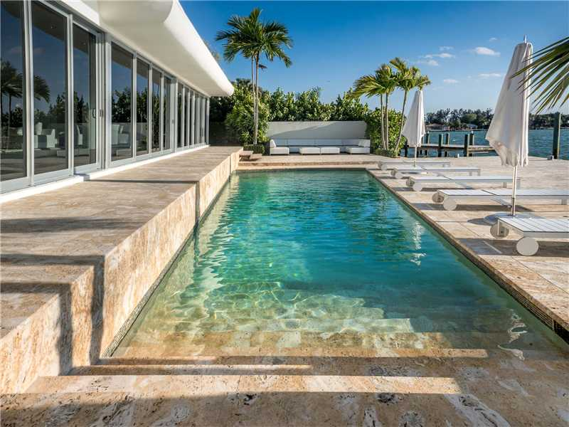 Pool overlooking the bay waterfront estate for sale. To learn more about Waterfront Homes in Biscayne Point & Stillwater call 954.557.5974